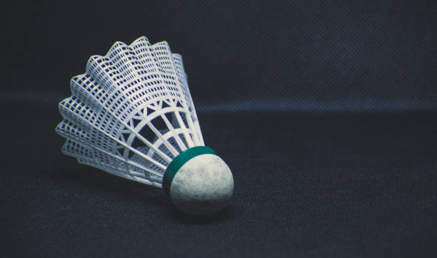 shuttlecock in a black background - shuttlecock stock pictures, royalty-free photos & images
