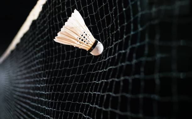 Shuttlecock in air Close-up of white shuttlecock hitting the net. badminton stock pictures, royalty-free photos & images