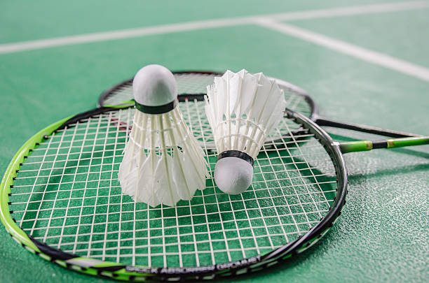 shuttlecock on badminton racket. shuttlecock on badminton racket. badminton stock pictures, royalty-free photos & images