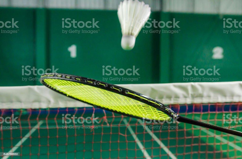 shuttlecock on badminton racket. stock photo