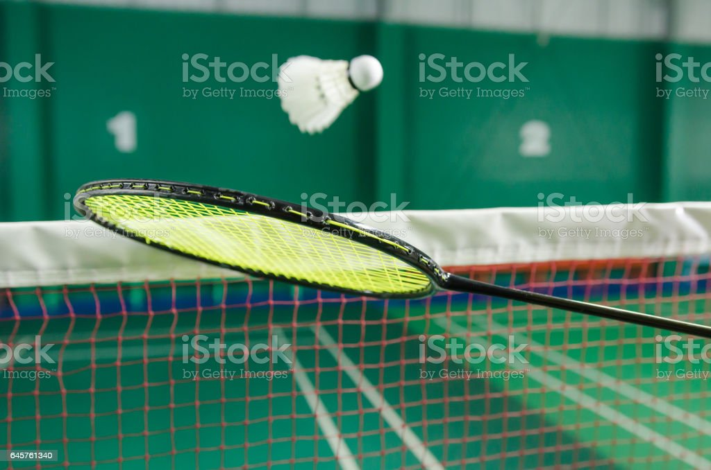 shuttlecock on badminton racket. stock photo