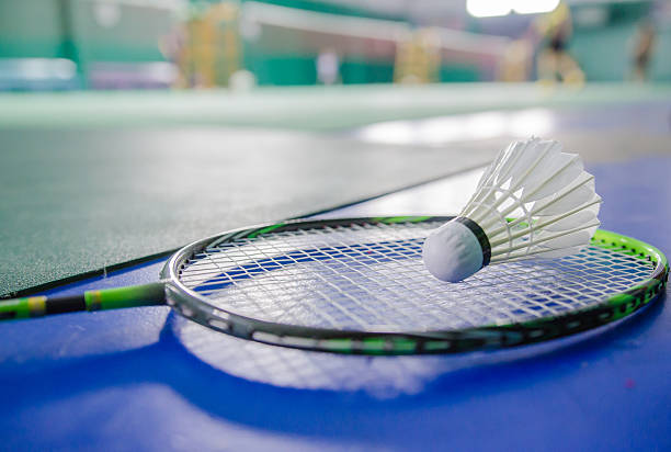 shuttlecock on badminton racket Soft-focus image shuttlecock on badminton racket Soft-focus image badminton stock pictures, royalty-free photos & images