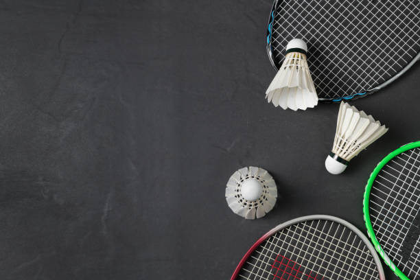 Shuttlecocks and badminton racket on black background. Shuttlecocks and badminton racket on black background.Sport concept, Concept winner, Copy space image for your text badminton stock pictures, royalty-free photos & images