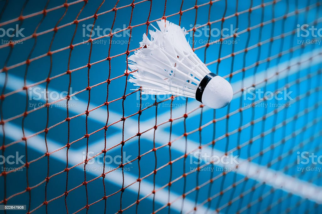 shuttlecocks struck on the net in badminton court stock photo