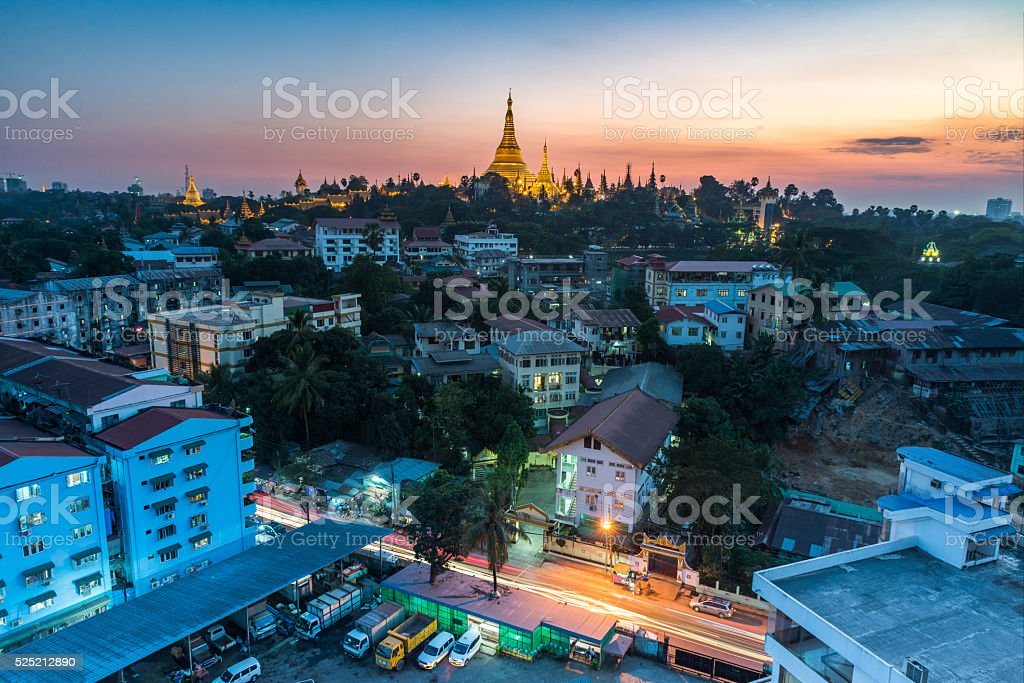 Shwedagon pagoda during sunset time with Yangong cityscape foreground Myanmar stock photo