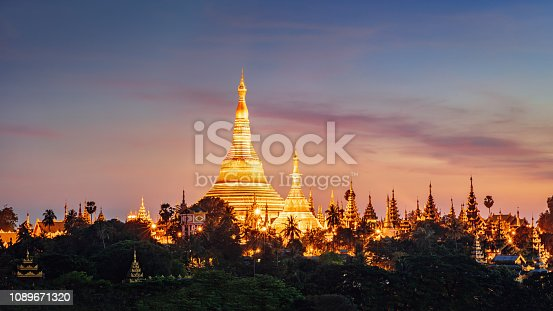Panorama of beautiful sunset over the famous Shwedagon Pagoda during sunset. Aerial skyline cityscape view from above. Yangong, Myanmar, Burma, Asia.