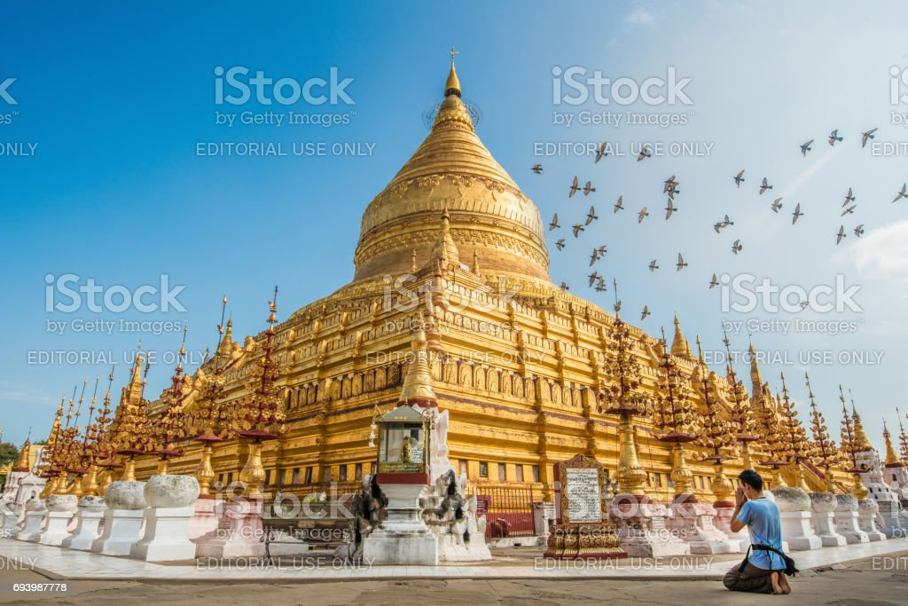 Shwezigon pagoda in old Bagan kingdom, Myanmar. stock photo