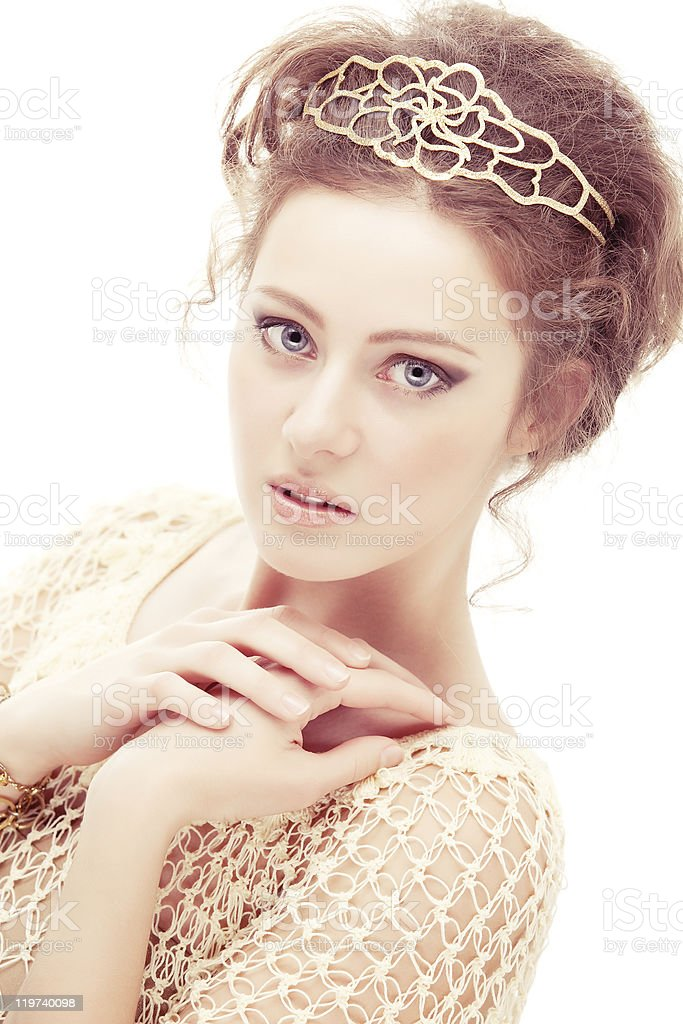 Shy girl in a diadem stock photo