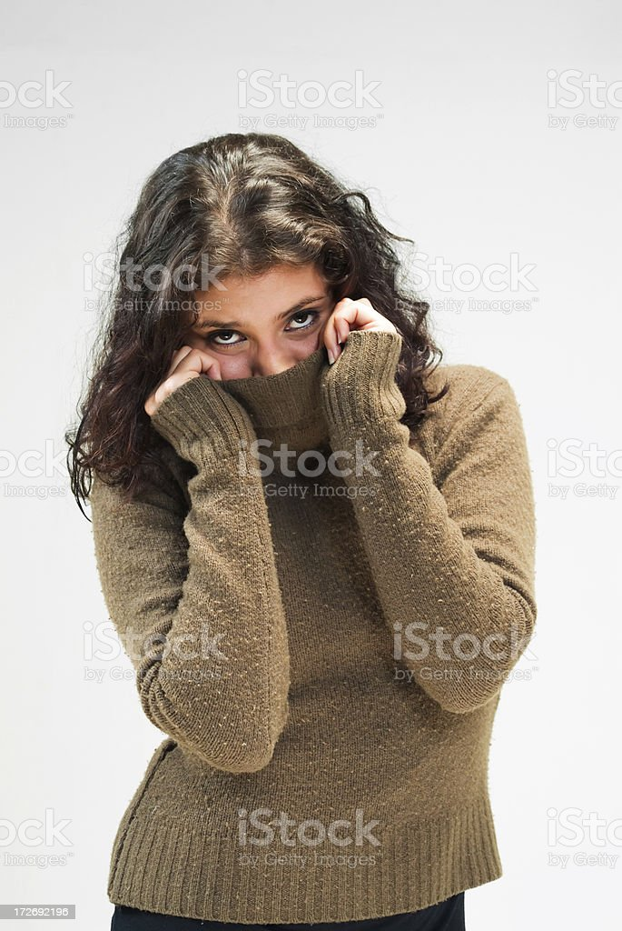 Shy girl with sweater royalty-free stock photo
