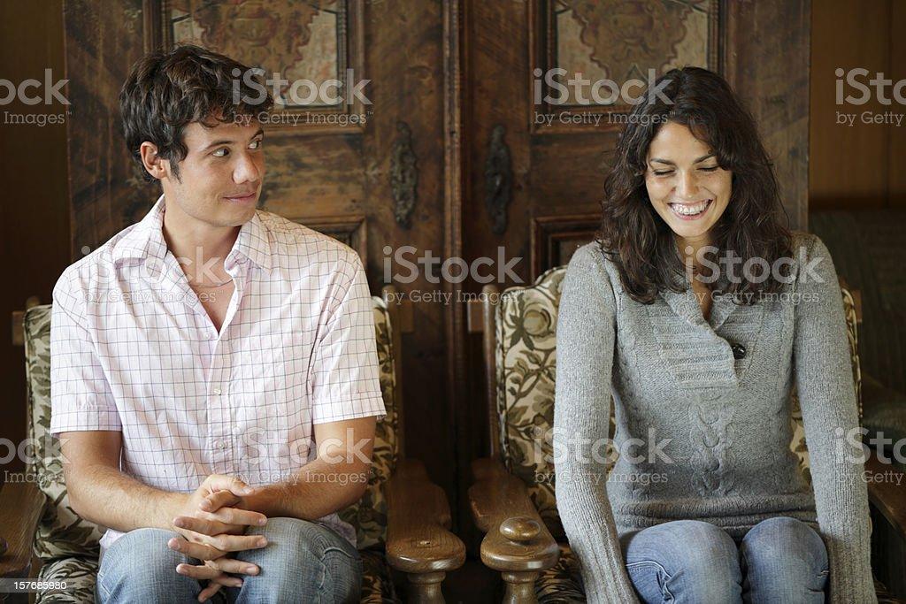 Shy man looking at the girl royalty-free stock photo