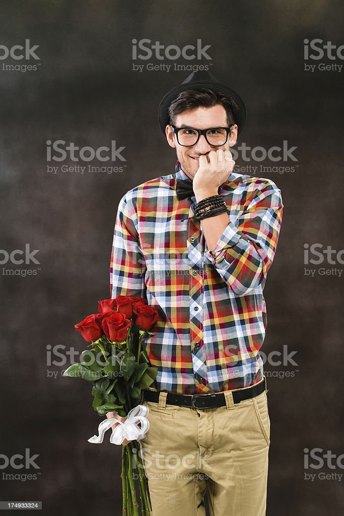 Shy Man With Red Roses stock photo
