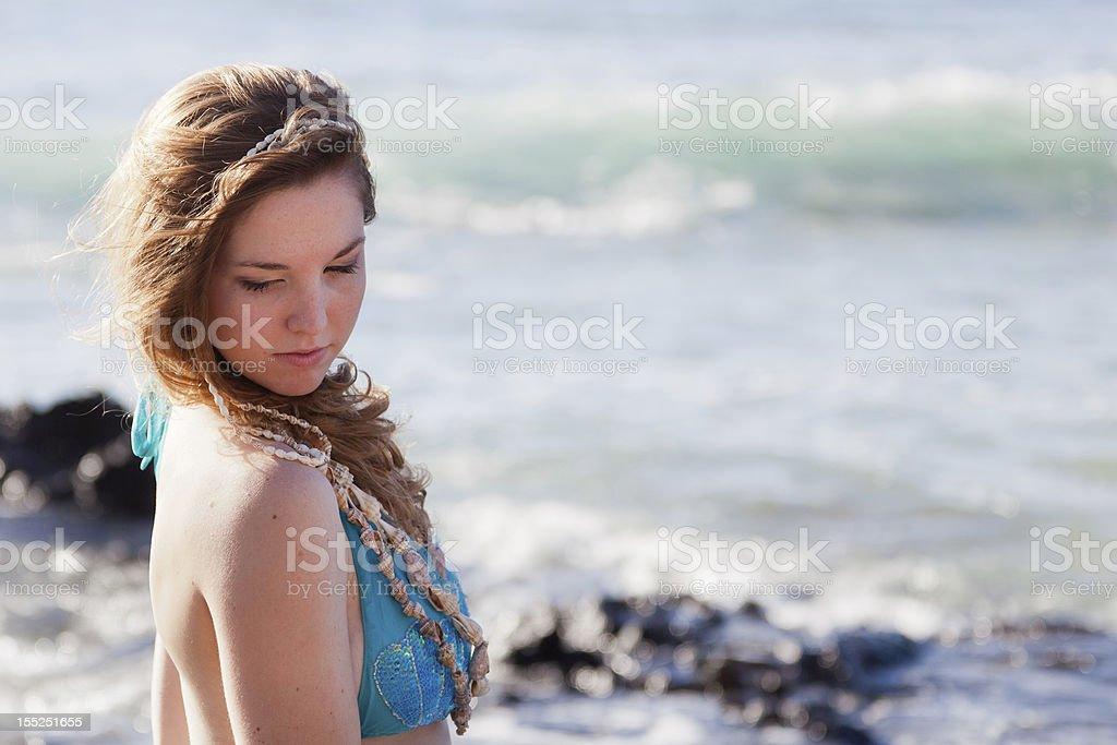 Shy Mermaid Looking Over her Shoulder stock photo