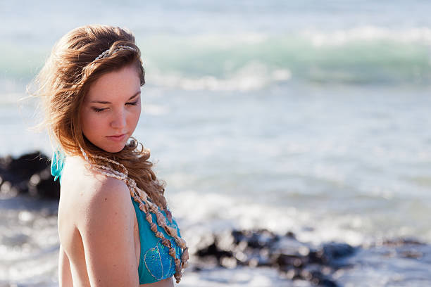 shy mermaid looking over her shoulder - carolinemaryan stock pictures, royalty-free photos & images