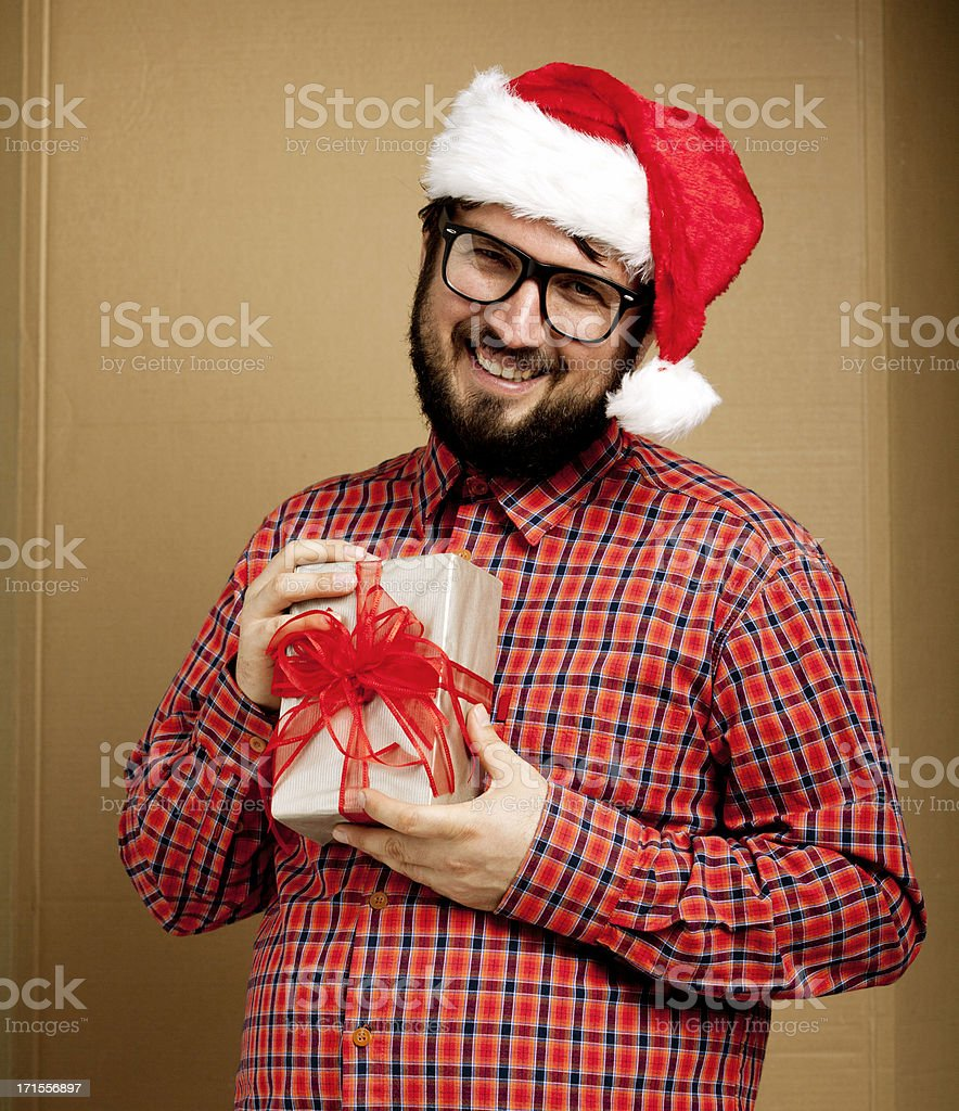 Shy nerd gay holding Christmas present royalty-free stock photo