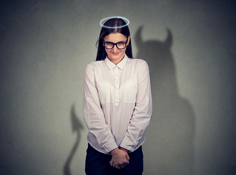 istock Shy quiet angel woman with devil character 678985338