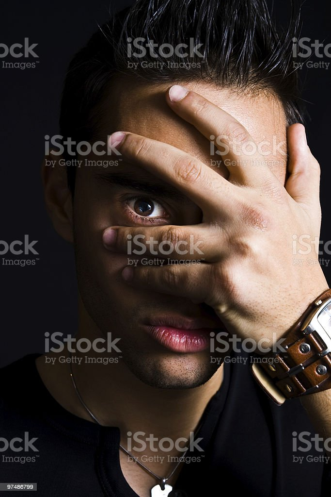 Shy spooky man hiding with hand on face royalty-free stock photo