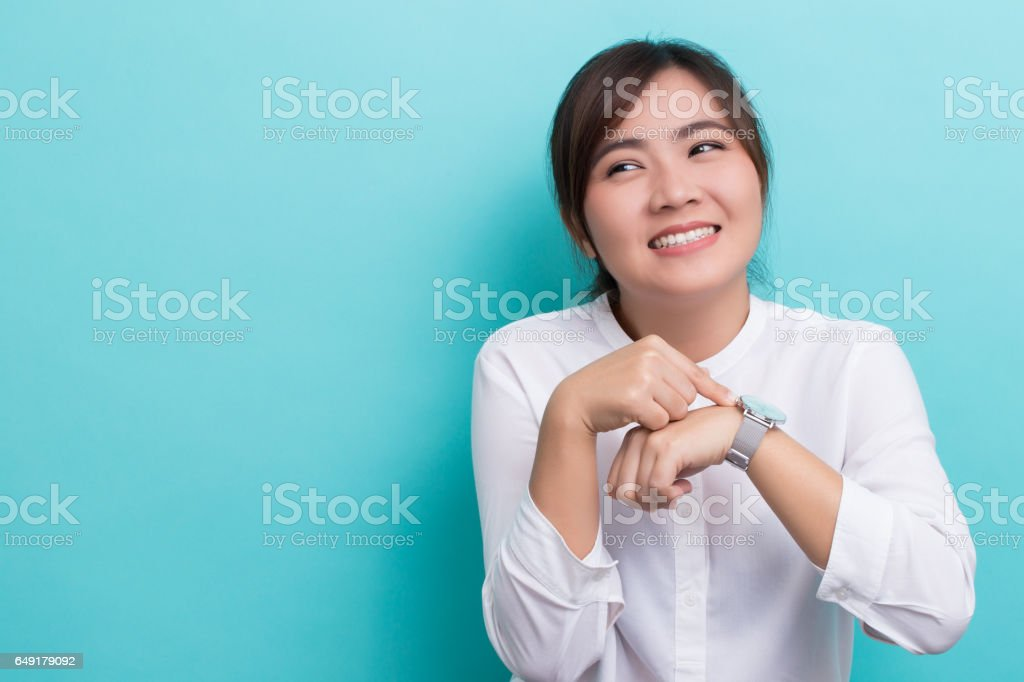 Shy woman check her watch she is late stock photo