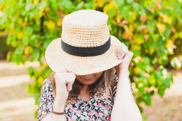 Shy woman covering her face stock photo