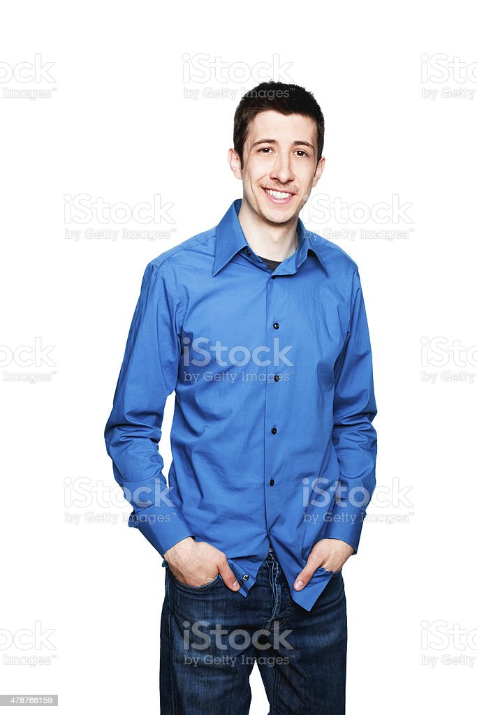Shy young man smiling stock photo