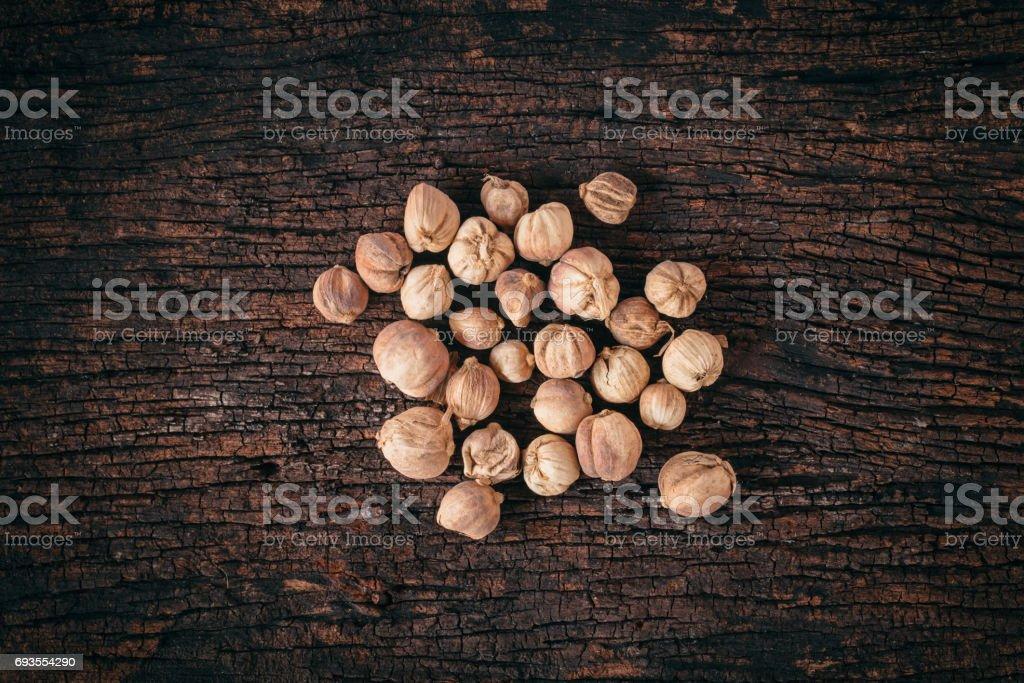 Siam Cardamom (Amomum krervanh Pierre) dried on wood background stock photo
