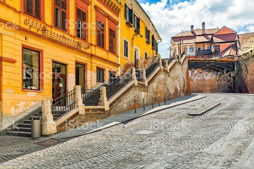 Sibiu cobblestone street passes under The Bridge of Lies stock photo
