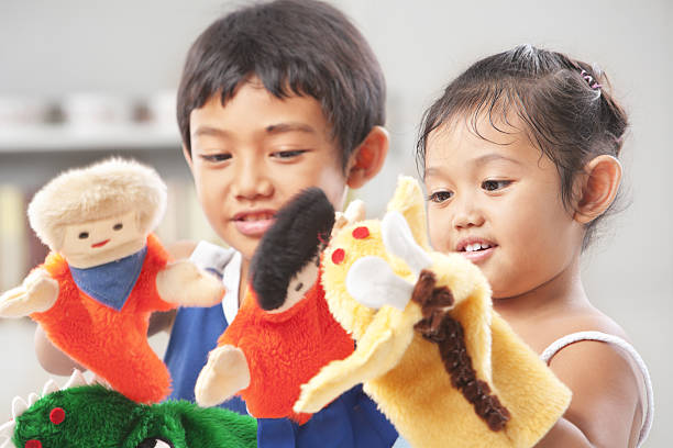 Sibling playing hand puppet Sibling playing hand puppets, which were  handmade puppet stock pictures, royalty-free photos & images