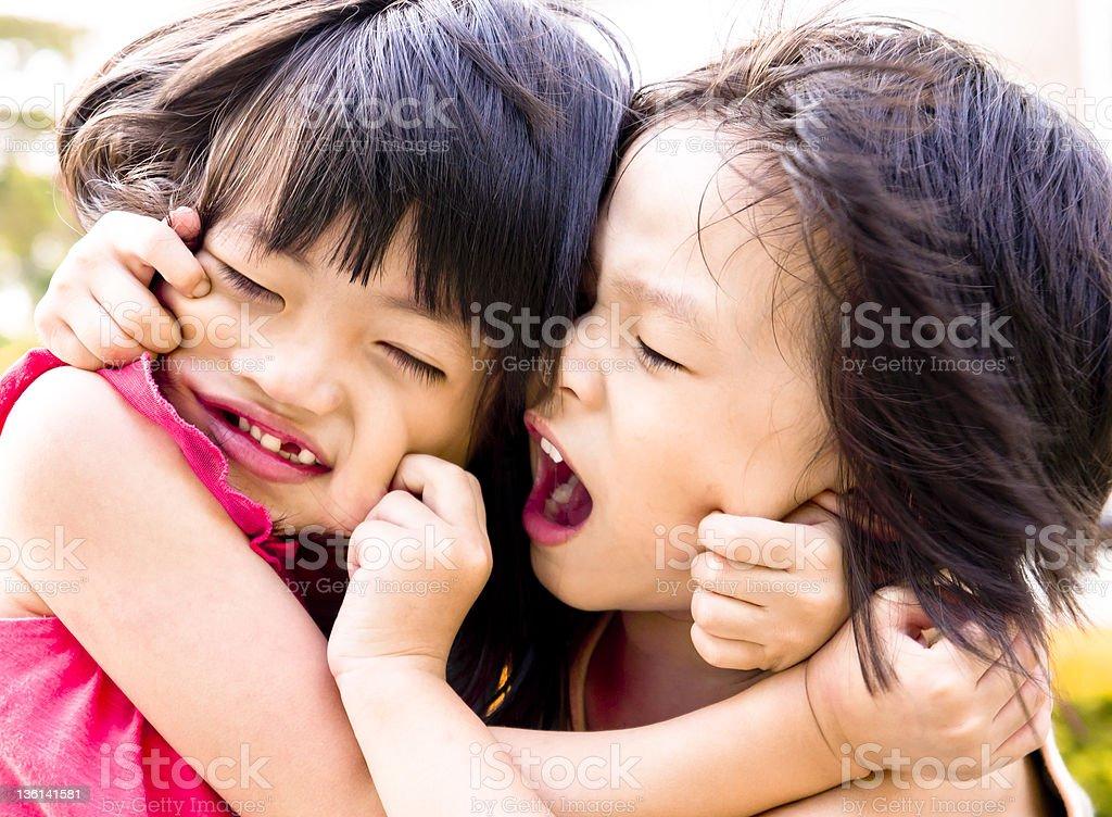 Sibling playing stock photo