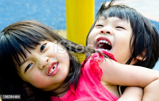 istock Sibling playing 136284464