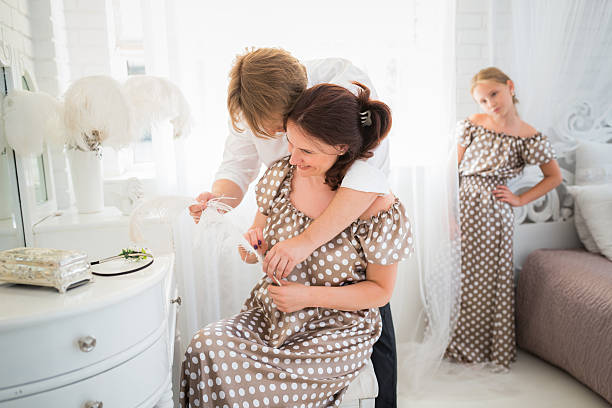 sibling rivalry - mom spying stock photos and pictures