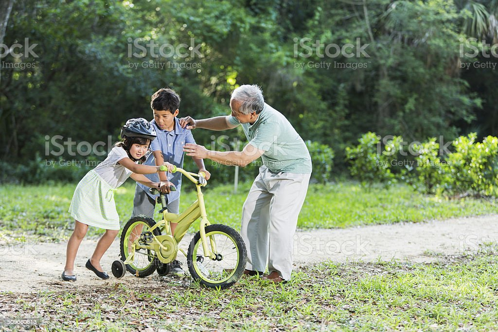 Sibling rivalry, with grandfather stock photo