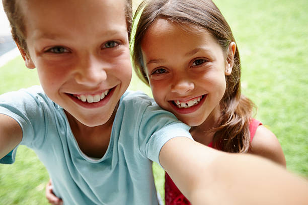 sibling selfie - sister stock photos and pictures