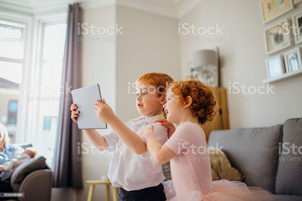 Sibling Selfies stock photo