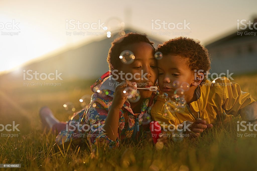 Siblings and the best of friends stock photo