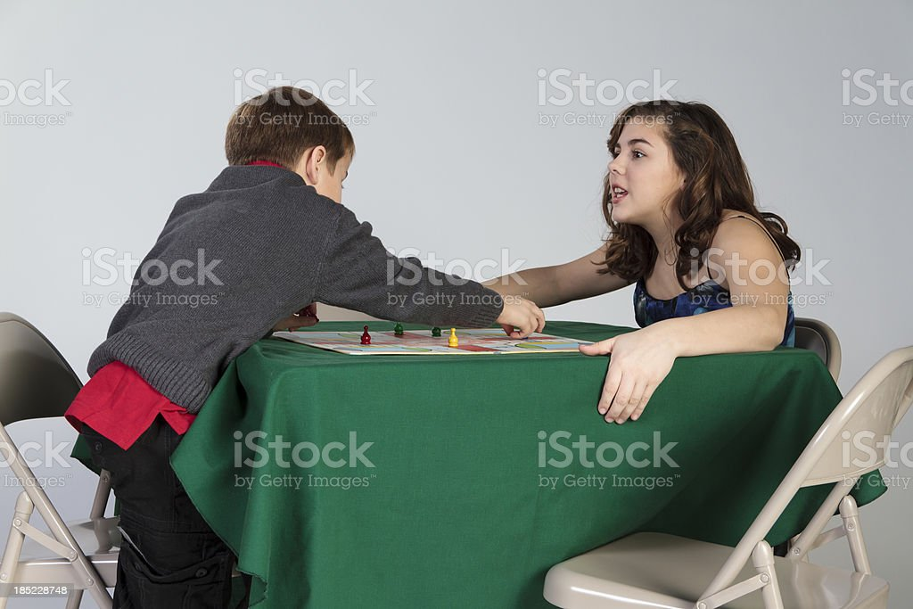 Siblings Argue Over a Game Move stock photo
