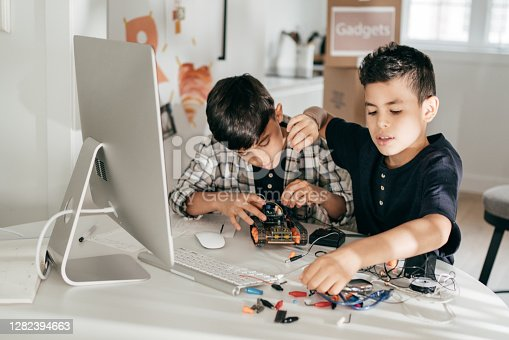 Siblings at home creating new airspace machine
