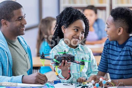 1016655140 istock photo Siblings build drone together at school 690657092