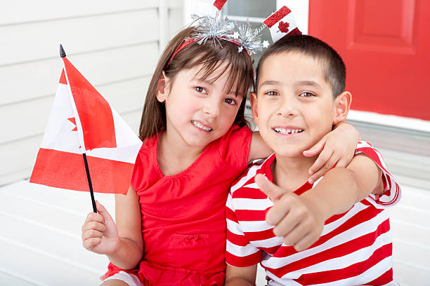 siblings celebrating canada day - canada day stock pictures, royalty-free photos & images