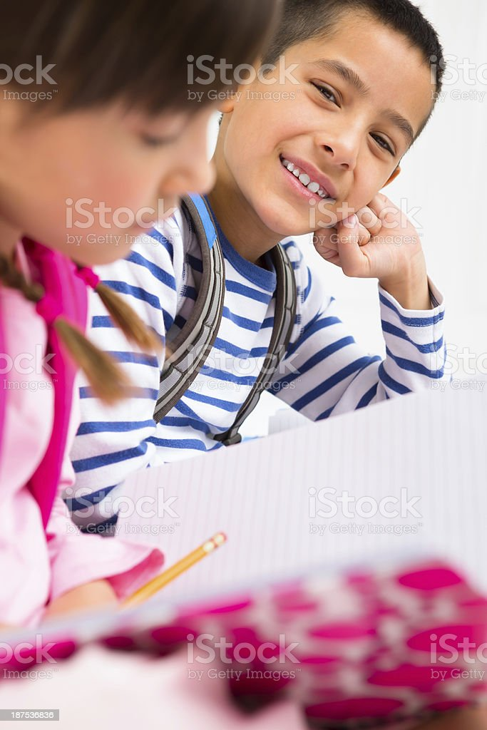 Siblings doing homework together royalty-free stock photo