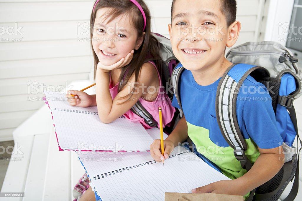 Siblings doing their homework stock photo