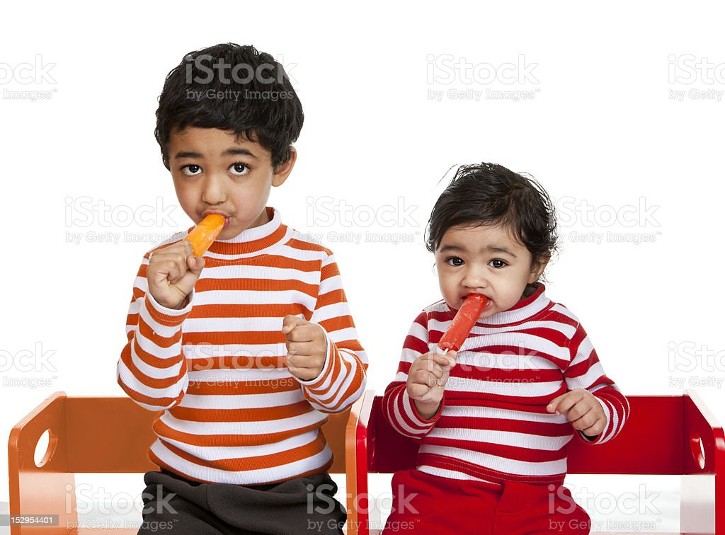 Siblings Enjoying Popsicles, Isolated, White stock photo