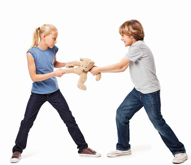 Toys For Siblings : Royalty free brother and sister fighting pictures images
