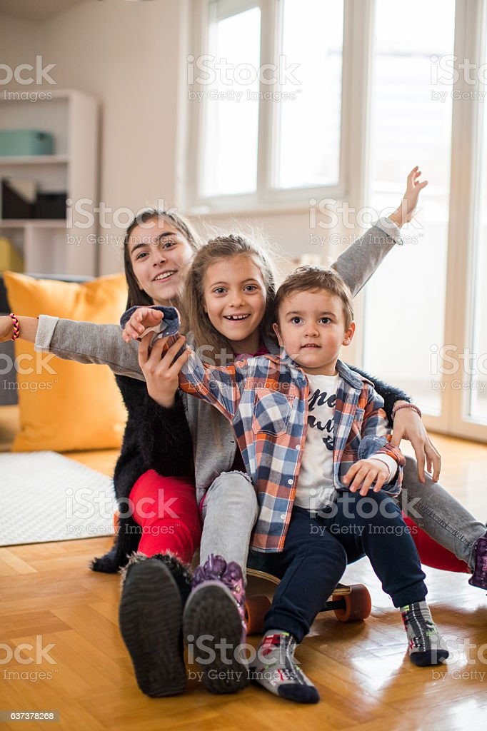 Siblings have the greatest fun stock photo