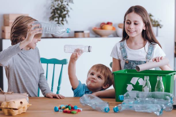 siblings having fun - biodegradabile foto e immagini stock