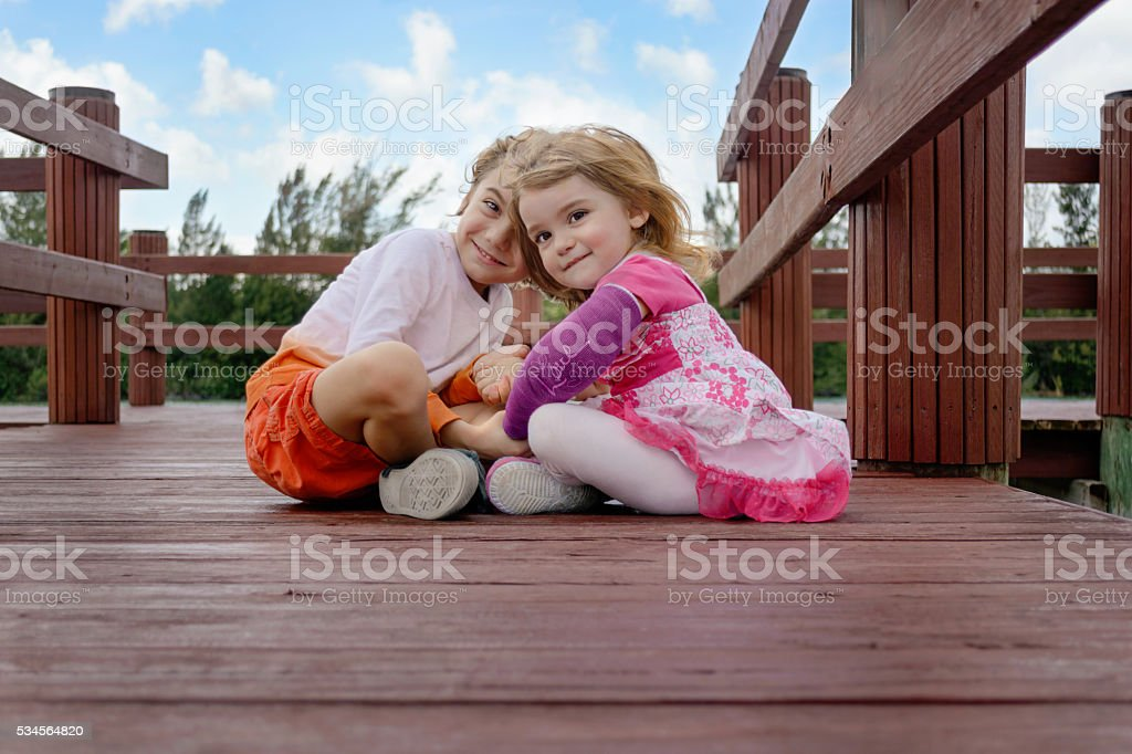 Siblings holding hands stock photo