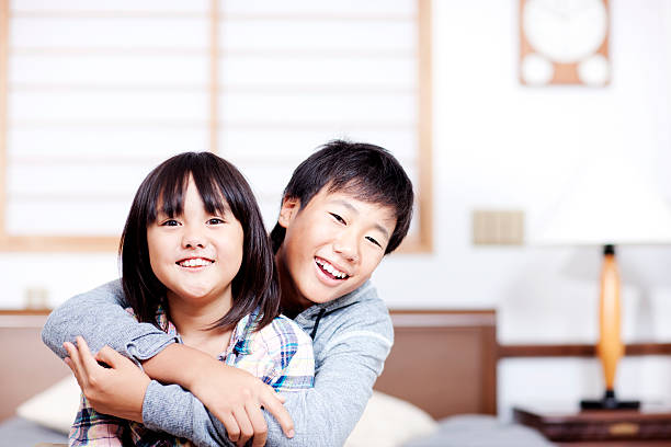 royalty free japanese brother and sister hugging each other pictures