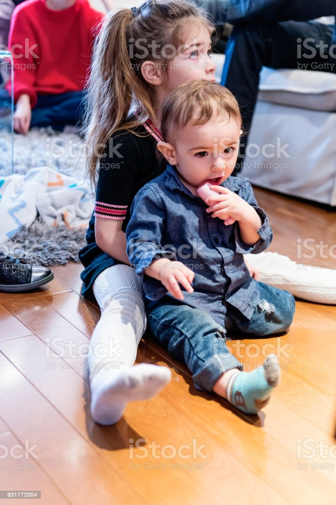 Siblings in family reunion watching video hommage. stock photo