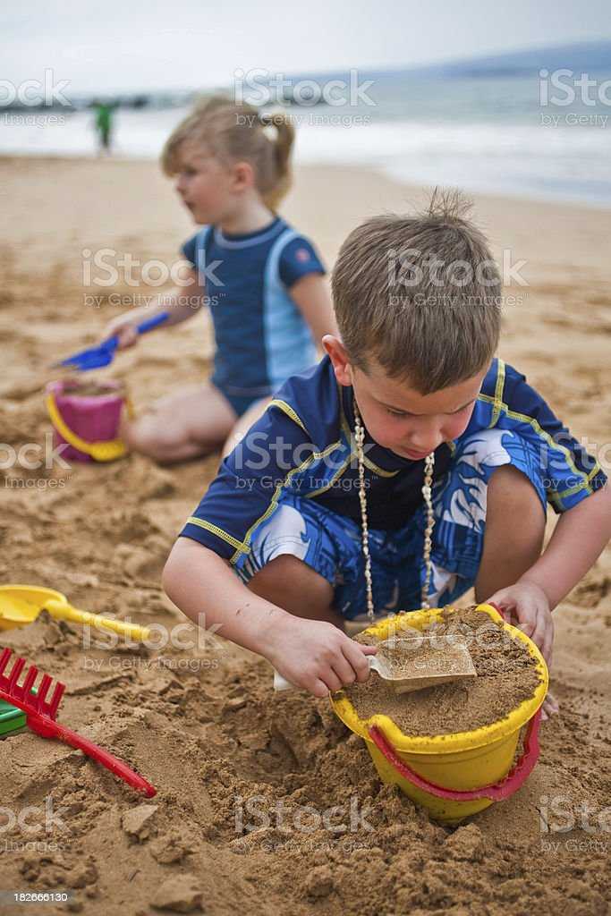 Siblings on Beach royalty-free stock photo