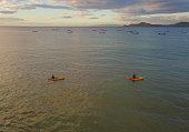 istock Siblings on kayaks at Playa Hermosa, Costa Rica drone view 1295091536