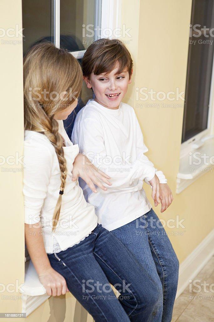 Siblings playing stock photo