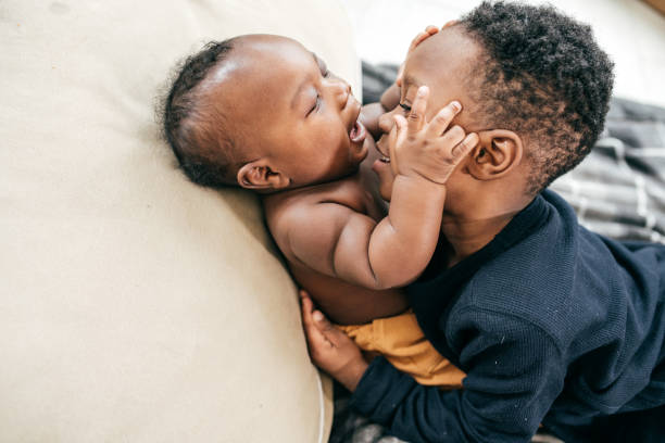 Siblings playing together Brother and little baby sibling stock pictures, royalty-free photos & images